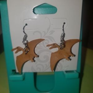 Toy dinosaur dangle earrings